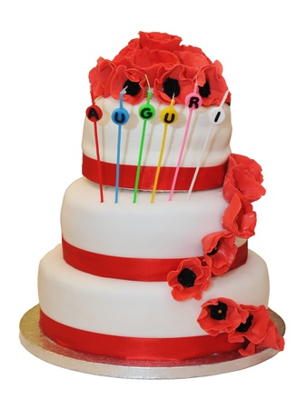 details on a wedding cake with red ribbons and decorations photo