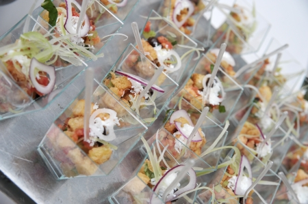 some little cups of food in a wedding banquet photo