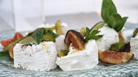ricotta cheese with tomato, black cherries, lime, figs and basil