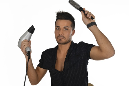 young man confused while hairdressing isolated on white background photo