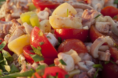 octopus salad in a wedding banquet with potatoes and tomatoes Stock Photo