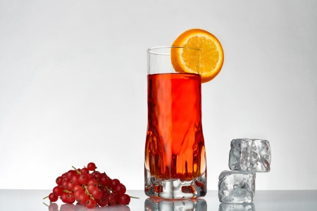 a fresh currants flavored drink on grey  Stock Photo