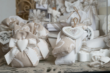 Favors on a table outdoor with boxes for wedding event selective focus Stock Photo