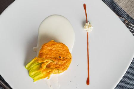 Pumpkin savory cupcake on a pecorino cheese cream tablemat