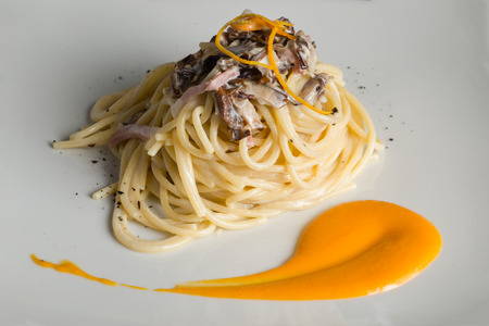 spaghetti with mushrooms speck and candied orange
