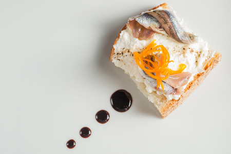 anchovies cheese and candied orange on bread Stock Photo