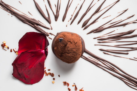chocolate ball with chilli pepper on a white dish