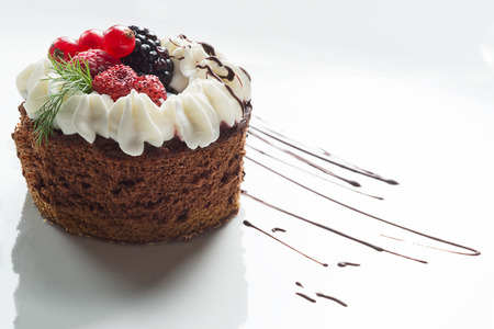 chocolate cake with fruits and cream