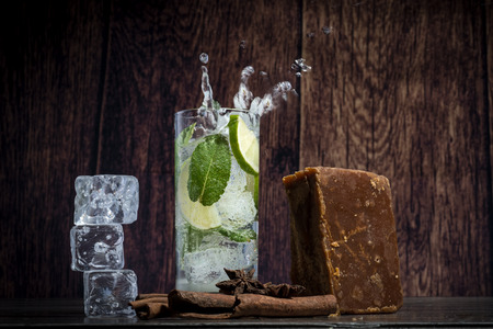 fresh mojito in a transparent glass on wooden background