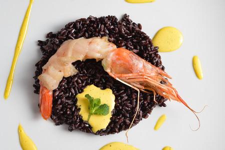black venus rice under shrimp lard wrapped Stock Photo