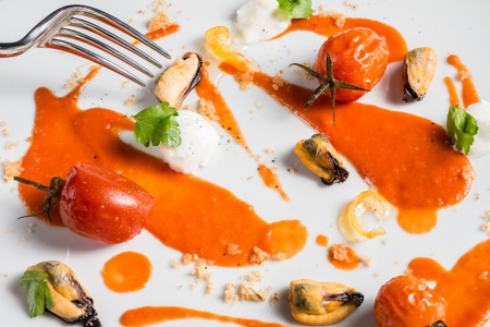 tomato, mozzarella cheese mussels and basil on a white dish Stock Photo