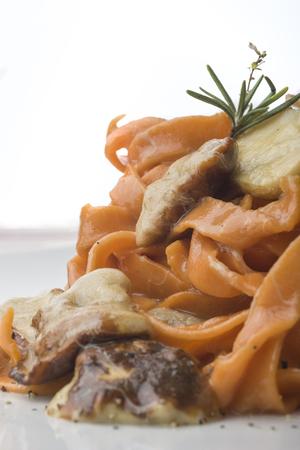 italian fettuccine with tomato and porcini mushrooms Stock Photo