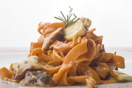 porcini: italian fettuccine with tomato and porcini mushrooms Stock Photo