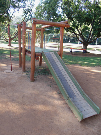 living things: Playground with a slide in a square or public park Stock Photo