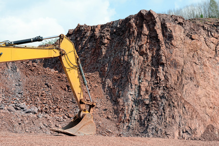 earthmover: earthmover shovel in a quarry ready to work Stock Photo