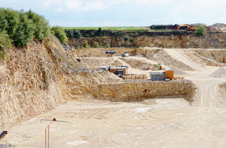 sedimentary rocks at a limestone quarry. open pit mine. mining industry.