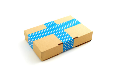 sellotape: package with blue textured tape on white isolated background Stock Photo