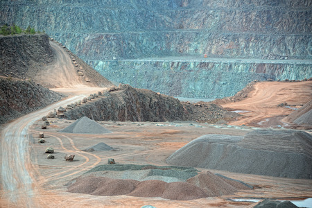 mining: view into an open pit mine. quarry. mining industry. Stock Photo