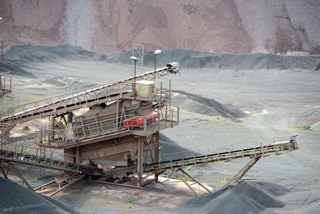 open pit: stone crusher machine in an open pit mine Stock Photo
