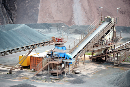 stone crusher in porphyry surface mine. hdr image 스톡 콘텐츠