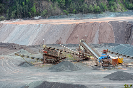 mining: stone crusher in surface mine. mining industry