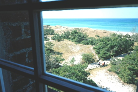 looking through window: looking through window of lighthouse at Western Pomerania Lagoon Area National Park with its beach, reed and dunes landscapes. Darsser ort is the peak of peninsular drass zingst (Mecklenburg-Vorpommern, Germany) Stock Photo