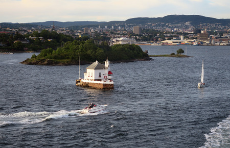 oslo: OSLO, OSLO Norway July 08 2016: Leaving harbor of Oslo. Cityscape of Oslo and historical fortress