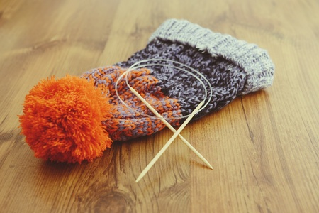 wooly: knitting needles with wooly hat. winter cloth handemade.