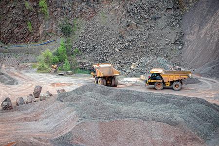 dumper: two dumper trucks in a quarry. mining industry.