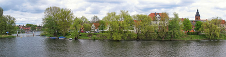 HAVELBERG, SAXONY-ANHALT GERMANY May 01 2015: Cityscape of Havelberg with Havel River with the St. Laurentius church. Panorama made of 3 seperate images