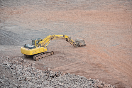 mover: earth mover in a Porphyry rock quarry. mining industry