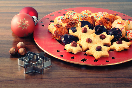 advent time: christmas cookies on plate with nutes and sweets. advent time.