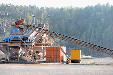 stone crusher in a quarry mine of porphyry rock. mining industry.