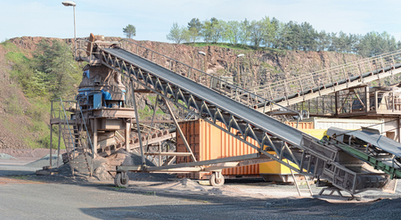 crushing: stone crusher in a quarry mine of porphyry rock. mining industry.