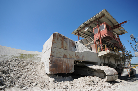 stone crusher machine in an open pit mine. mining industry. chalk sediment rocks