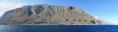 panoramic image of Crete (Greece) mountains of Libyan Sea side. driving with a boat along from Samaria gorge towards Loutro village. made of 5 images.