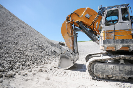 dredging: Excavator and Equipment in a chalk quarry. mining industry Stock Photo