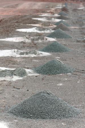 driller drilling holes on rock for detonation.mining industry. 版權商用圖片