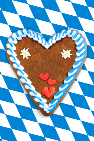 Oktoberfest Gingerbread heart with copy space on bavarian white blue flag