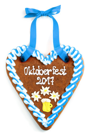 heartshaped: Oktoberfest Gingerbread heart 2017 on white isolated background.