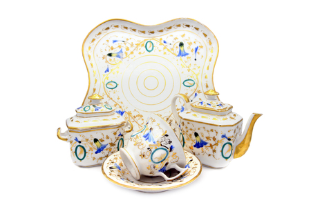 Antique Biedermeider coffee and tea time set with plat, cup and pot. white isolated background Stock Photo
