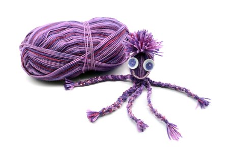 handmade octopus of wool on white isolated  background.