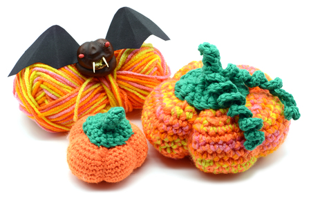 Autumn decoration crochet pumpkin and halloween bat of chestnut.