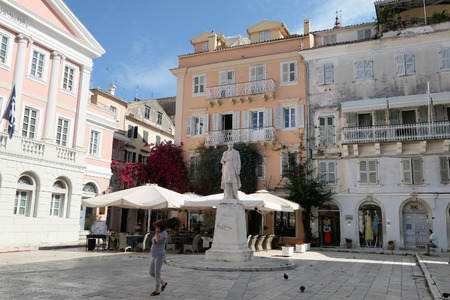 Corfu Town, Corfu / GREECE May 31 2018: Cityscape of Corfu Town (Greece) with its typical old town part. People walking around passing by small bars and restaurants.