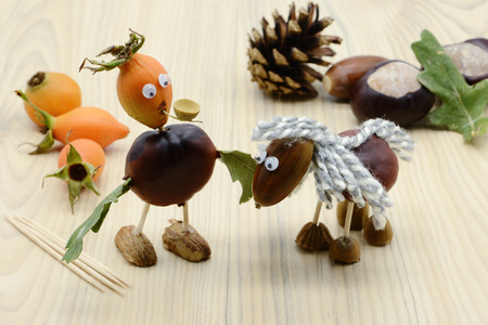 creating acorn chestnut figures like horse and and man with pipe in autumn time. childhood tinker.