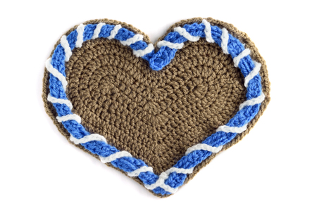 crochet Gingerbread heart shape valentines day gift with copy space on white isolated background. Stok Fotoğraf