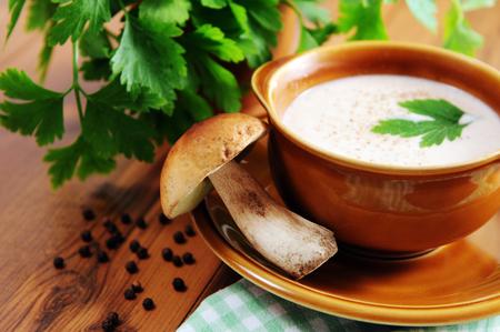 cepe bun mushroom cream soup in bowl with fresh parsley