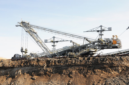 a brown coal mine with a Bucket-wheel excavator