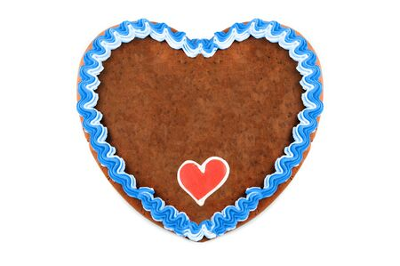 Oktoberfest Gingerbread heart cookie with ornaments and copy space. Oktoberfest is a october fest in munich germany for beer and bavarian food.