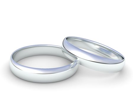 silver wedding rings isolated on a white background photo